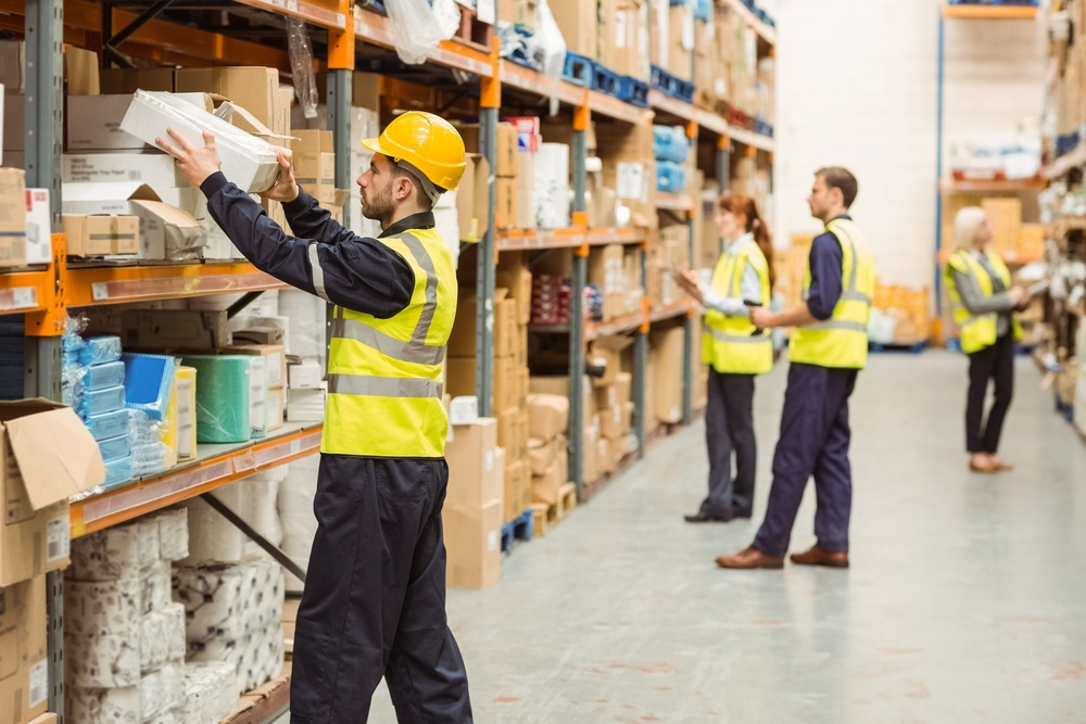 Warehouse worker taking package in the shelf in a large warehouse in a large warehouse.jpeg