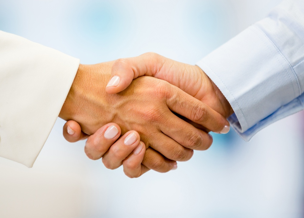 Business handshake closing a deal at the office.jpeg