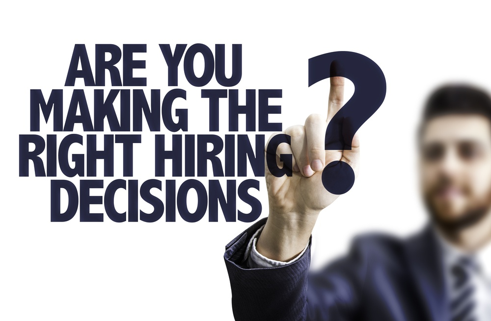 Business man pointing the text Are You Making the Right Hiring Decisions?.jpeg