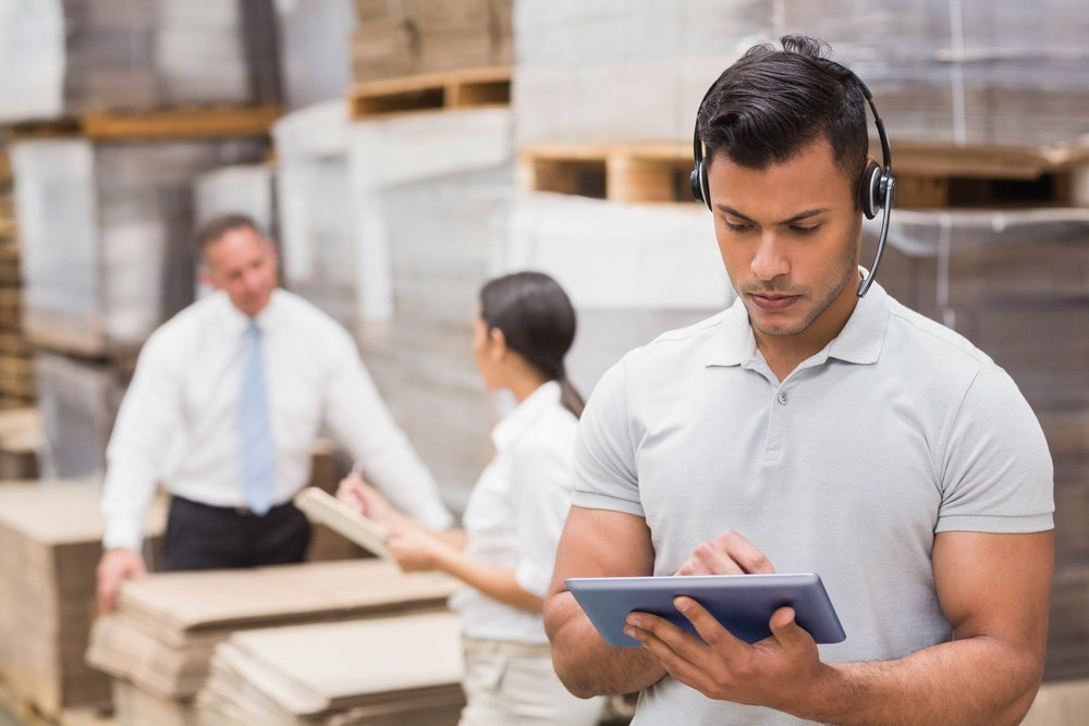 Female manager using digital tablet in warehouse.jpeg