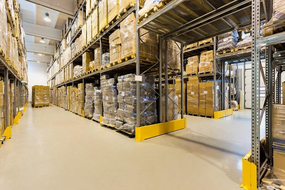 Interior of a huge spacious warehouse with carton boxes.jpeg